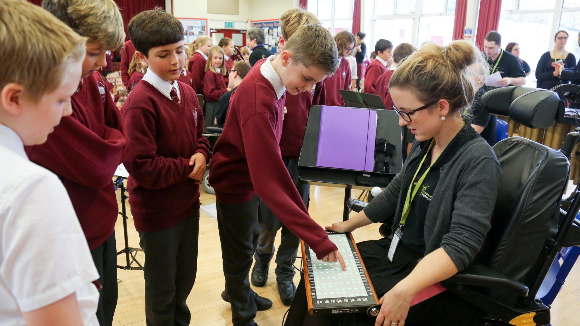 . Pupils talk to Charlotte Bott with her Linnstrument.