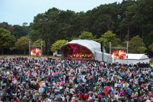 As the sun sets on Meyrick Park, the Orchestra and singers get the Disco Spectacular underway in front of a large crowd