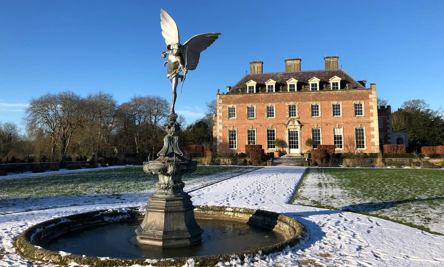 A picture of St Giles House in the snow