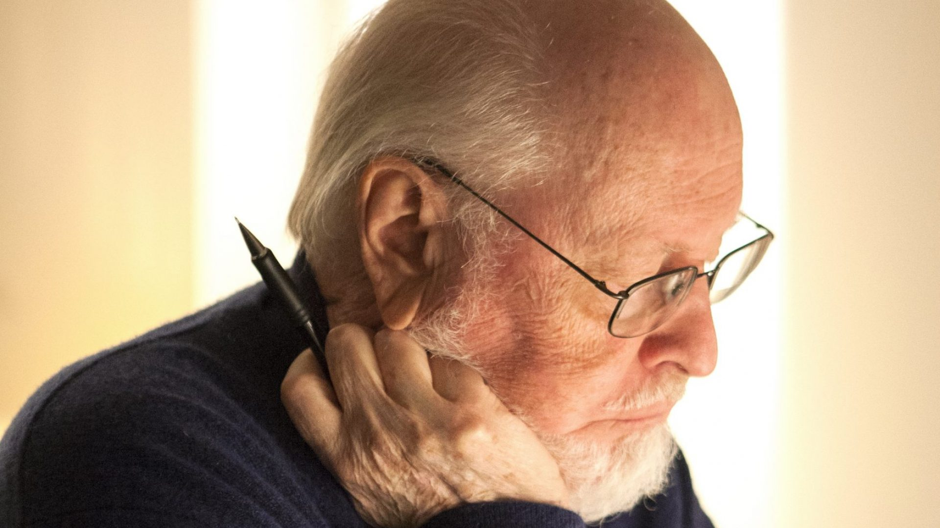 John Williams looking at a piece of paper